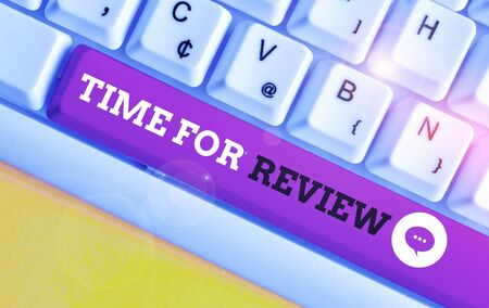 Writing note showing Time For Review. Business concept for review of a system or situation in its formal examination White pc keyboard with note paper above the white background 写真素材 - 132122655