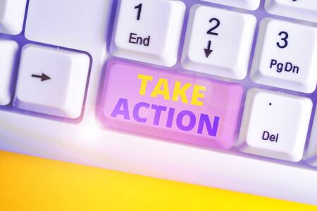 Handwriting text Take Action. Conceptual photo advices someone to do something or reaction right now White pc keyboard with empty note paper above white background key copy space