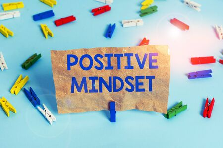 Text sign showing Positive Mindset. Business photo text mental attitude in wich you expect favorable results Colored clothespin papers empty reminder blue floor background office pin Zdjęcie Seryjne