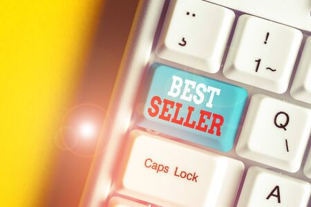 Writing note showing Best Seller. Business concept for book or other product that sells in very large numbers White pc keyboard with note paper above the white background