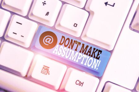 Text sign showing Don T Make Assumption. Business photo showcasing something that you assume to be case even without proof White pc keyboard with empty note paper above white background key copy space