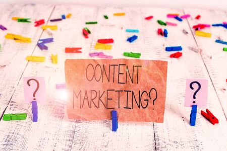 Text sign showing Content Marketing Question. Business photo text involves creation and sharing of online material Scribbled and crumbling sheet with paper clips placed on the wooden table