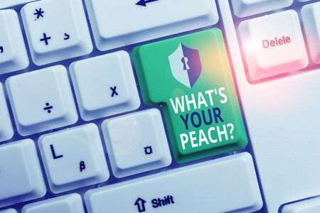 Handwriting text writing What S Is Your Peach question. Conceptual photo an exceptionally good demonstrating or thing White pc keyboard with empty note paper above white background key copy space Stock Photo