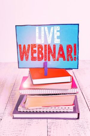 Writing note showing Live Webinar. Business concept for presentation lecture or seminar transmitted over Web pile stacked books notebook pin color reminder white wooden 版權商用圖片 - 132126126