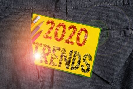 Handwriting text writing 2020 Trends. Conceptual photo things that is famous for short period of time in current year Writing equipment and yellow note paper inside pocket of man work trousers Zdjęcie Seryjne