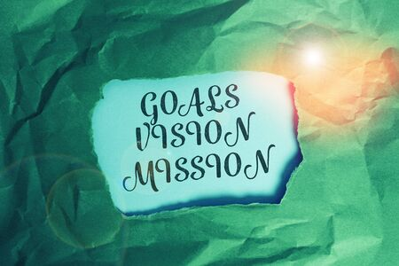 Text sign showing Goals Vision Mission. Business photo text practical planning process used to help community group Green crumpled ripped colored paper sheet centre torn colorful background 版權商用圖片