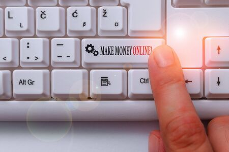 Conceptual hand writing showing Make Money Online. Concept meaning making profit using internet freelancing or marketing White pc keyboard with note paper above the white background