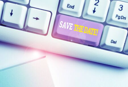 Word writing text Save The Date. Business photo showcasing remember not schedule anything else on this day White pc keyboard with empty note paper above white background key copy space 写真素材