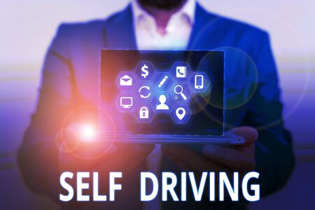 Conceptual hand writing showing Self Driving. Concept meaning Autonomous vehicle Ability to navigate without huanalysis input
