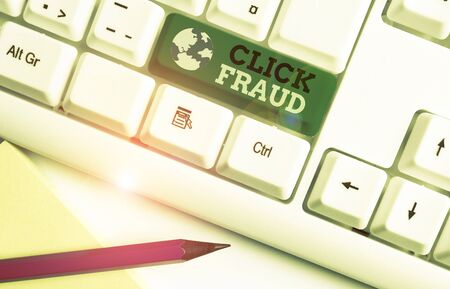 Writing note showing Click Fraud. Business concept for practice of repeatedly clicking on advertisement hosted website White pc keyboard with note paper above the white background