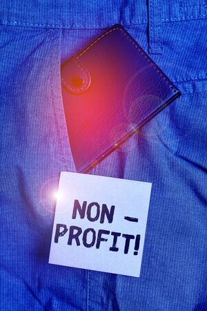 Conceptual hand writing showing NonProfit. Concept meaning not making or conducted primarily to make profit organization Small wallet inside trouser front pocket near notation paper