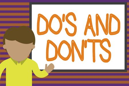 Text sign showing Do S And Don tS. Business photo text Rules or customs concerning some activity or actions Young man standing in front whiteboard pointing to project. photo Art