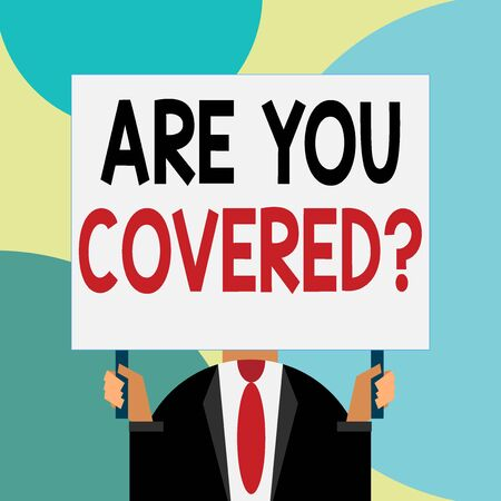 Handwriting text writing Are You Covered Question. Conceptual photo asking showing if they had insurance in work or life Just man chest dressed dark suit tie no face holding blank big rectangle