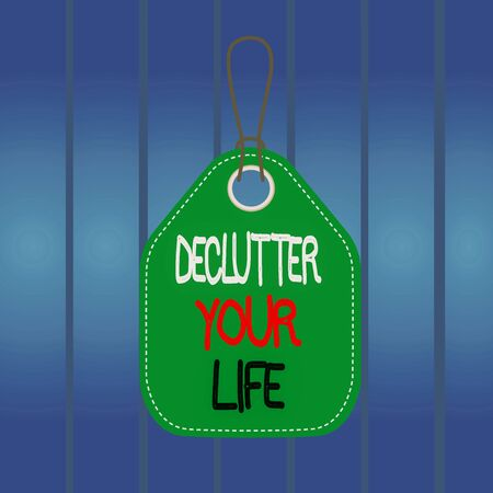 Writing note showing Declutter Your Life. Business concept for To eliminate extraneous things or information in life Empty tag colorful background label rectangle attach string