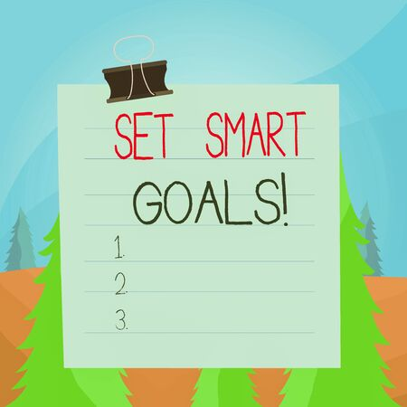 Word writing text Set Smart Goals. Business photo showcasing list to clarify your ideas focus efforts use time wisely Paper lines binder clip cardboard blank square notebook color background