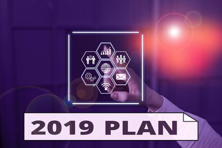 Handwriting text writing 2019 Plan. Conceptual photo setting up your goals and plans for the current year or in 2019 Picture photo system network scheme modern technology smart device
