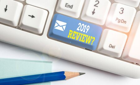 Word writing text 2019 Review Question. Business photo showcasing remembering past year events main actions or good shows White pc keyboard with empty note paper above white background key copy space