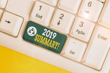 Handwriting text writing 2019 Summary. Conceptual photo summarizing past year events main actions or good shows White pc keyboard with empty note paper above white background key copy space