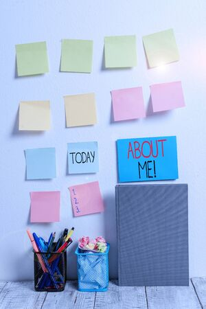 Conceptual hand writing showing About Me. Concept meaning telling someone list of your good and bad properties Sticky Notes Card on Wall Pencil Pots Notebook on Work Desk Banco de Imagens