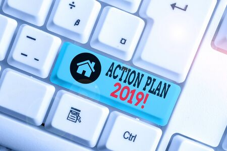 Text sign showing Action Plan 2019. Business photo text proposed strategy or course of actions for current year White pc keyboard with empty note paper above white background key copy space