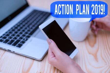 Text sign showing Action Plan 2019. Business photo showcasing proposed strategy or course of actions for current year woman laptop computer smartphone mug office supplies technological devices Banco de Imagens