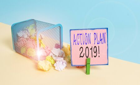 Text sign showing Action Plan 2019. Business photo text proposed strategy or course of actions for current year Trash bin crumpled paper clothespin empty reminder office supplies tipped Banco de Imagens