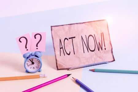 Writing note showing Act Now. Business concept for do not hesitate and start working or doing stuff right away Mini size alarm clock beside stationary on pastel backdrop 写真素材
