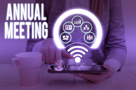 Writing note showing Annual Meeting. Business concept for yearly meeting of the general membership of an organization Picture photo network scheme with modern smart device