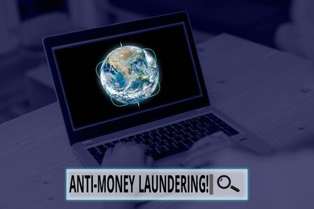 Conceptual hand writing showing Anti Money Laundering. Concept meaning regulations stop generating income through illegal actions Picture photo network scheme with modern smart device