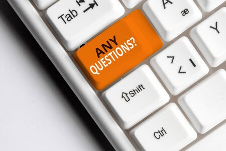Text sign showing Any Questions Question. Business photo text you say write order to ask demonstrating about something White pc keyboard with empty note paper above white background key copy space