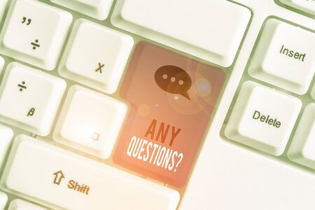 Word writing text Any Questions Question. Business photo showcasing you say write order to ask demonstrating about something White pc keyboard with empty note paper above white background key copy space