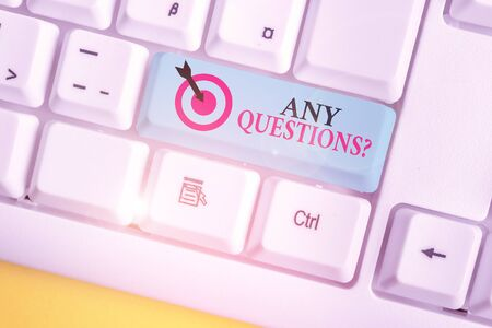 Text sign showing Any Questions Question. Business photo showcasing you say write order to ask demonstrating about something White pc keyboard with empty note paper above white background key copy space