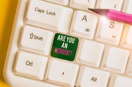 Word writing text Are You An Introvertquestion. Business photo showcasing demonstrating who tends to turn inward mentally White pc keyboard with empty note paper above white background key copy space Stok Fotoğraf