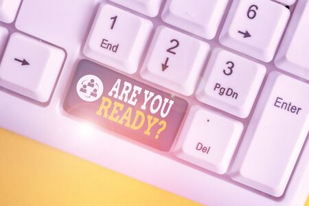 Handwriting text writing Are You Ready Question. Conceptual photo used telling someone start something when feel prepared White pc keyboard with empty note paper above white background key copy space