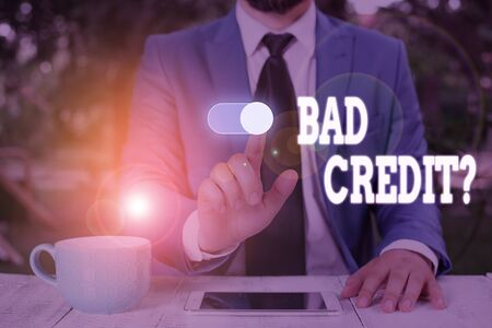 Conceptual hand writing showing Bad Creditquestion. Concept meaning inabilityof a demonstrating to repay a debt on time and in full Male wear formal work suit presenting presentation smart device