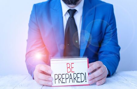 Writing note showing Be Prepared. Business concept for try be always ready to do or deal with something Man holds empty paper with copy space in front of him Space