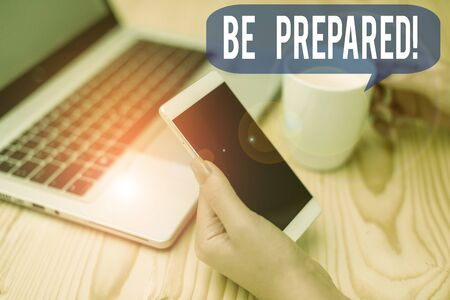 Text sign showing Be Prepared. Business photo showcasing try be always ready to do or deal with something woman laptop computer smartphone mug office supplies technological devices