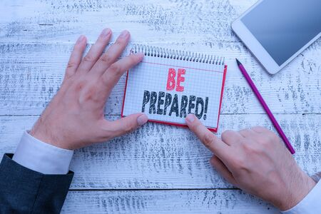 Text sign showing Be Prepared. Business photo text try be always ready to do or deal with something Hand hold note paper near writing equipment and modern smartphone device 스톡 콘텐츠