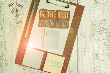 Handwriting text writing Be The Best Version Of You. Conceptual photo going to move away from where are start improving Clipboard sheet crushed sticky note clip notepads marker wooden background