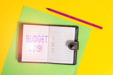 Text sign showing Budget 2019. Business photo showcasing estimate of income and expenditure for current year Dark leather private locked diary striped sheets marker colored background Stockfoto