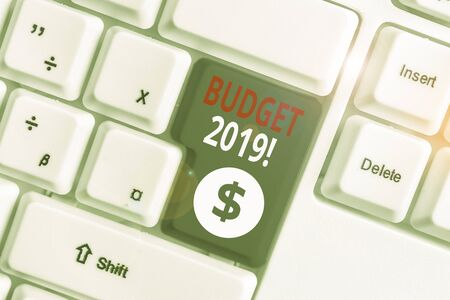 Writing note showing Budget 2019. Business concept for estimate of income and expenditure for current year White pc keyboard with note paper above the white background 写真素材 - 132245436