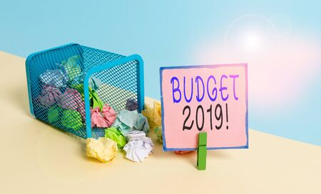 Text sign showing Budget 2019. Business photo text estimate of income and expenditure for current year Trash bin crumpled paper clothespin empty reminder office supplies tipped