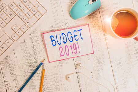 Handwriting text Budget 2019. Conceptual photo estimate of income and expenditure for current year technological devices colored reminder paper office supplies keyboard mouse 写真素材 - 132245923