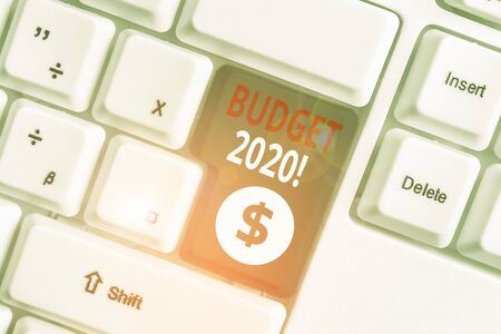 Writing note showing Budget 2020. Business concept for estimate of income and expenditure for next or current year White pc keyboard with note paper above the white background 写真素材 - 132242582