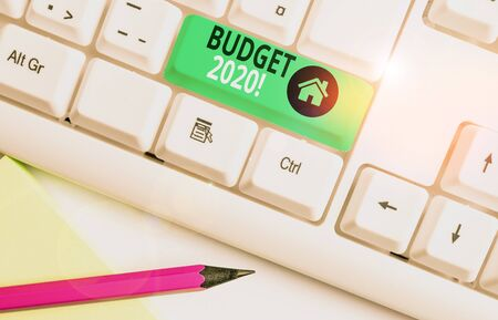 Handwriting text writing Budget 2020. Conceptual photo estimate of income and expenditure for next or current year White pc keyboard with empty note paper above white background key copy space 写真素材 - 132245011
