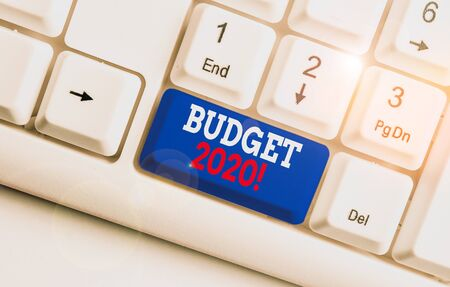 Text sign showing Budget 2020. Business photo text estimate of income and expenditure for next or current year White pc keyboard with empty note paper above white background key copy space 写真素材 - 132245451