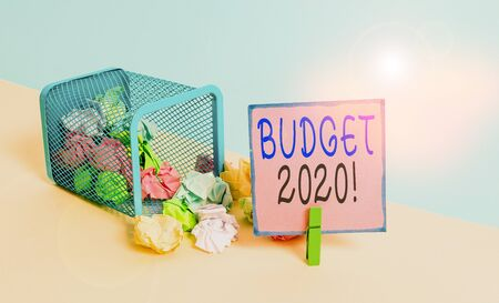 Text sign showing Budget 2020. Business photo text estimate of income and expenditure for next or current year Trash bin crumpled paper clothespin empty reminder office supplies tipped 写真素材 - 132244240