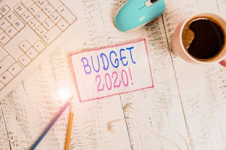 Handwriting text Budget 2020. Conceptual photo estimate of income and expenditure for next or current year technological devices colored reminder paper office supplies keyboard mouse 写真素材 - 132245056