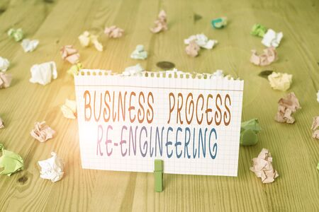 Text sign showing Business Process Re Engineering. Business photo text the analysis and design of workflows Colored crumpled papers empty reminder wooden floor background clothespin