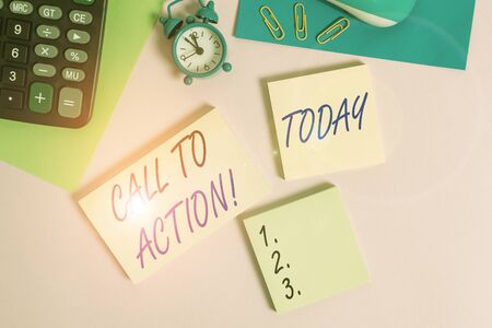 Text sign showing Call To Action. Business photo showcasing exhortation do something in order achieve aim with problem Wire mouse portable calculator notepads paper sheets clips color background